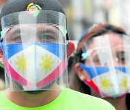 December 21 2020   A man with his companion wear face masks resembling the Philippine flag in Divisoria, Manila on monday, as the IATF recently announced that wearing face shields along with face mask even when out in public is now mandatory. INQUIRER/ MARIANNE BERMUDEZ